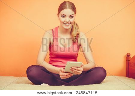 Young Woman Using Computer Tablet Browsing Internet. Fitness Sporty Girl Holding Ebook. Technology L
