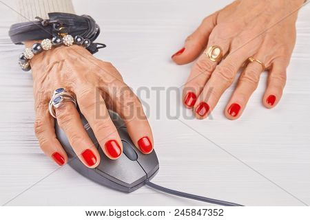 Old Woman Manicured Hand Using Pc Mouse. Close Up Woman Hand With Luxury Rings And Bracelets Operati