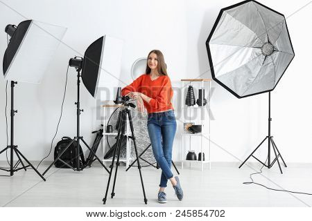 Young female photographer in studio