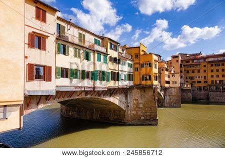 Picturesque Ponte Vecchio (Old Bridge) medieval closed-spandrel segmental bridge over the Arno River, a popular tourist attraction of  Florence, Tuscany, Italy poster