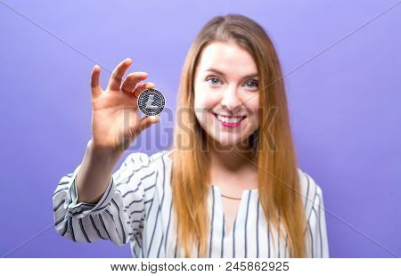 Woman Holding A Physical Litecoin In Her Hand