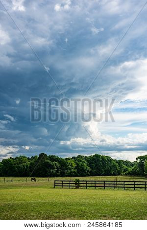 Thundercloud Formation Over Pasture Farmland In Vertical Format