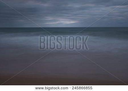 Early Morning At An Australian Beach Alongside The Iconic Great Ocean Road (long Exposure Of The Sur