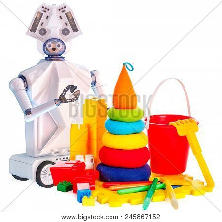 Robot toy on wheels and kids plastic toys. White plastic ai robotic device and pyramid with touch screen for children on isolated.
