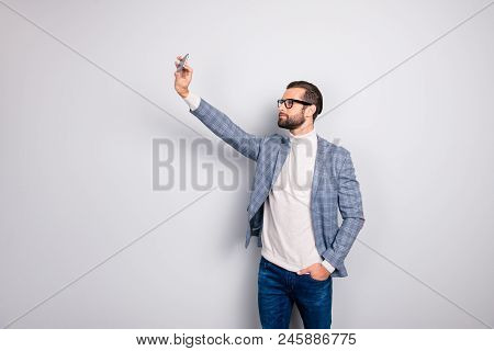 Virile, Harsh, Education, Attractive Man In Jacket Shooting Self Picture On Smart Phone Front Camera