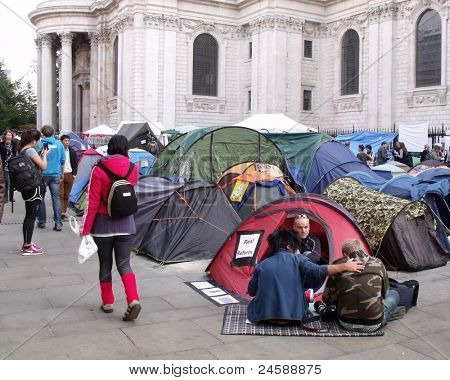 LONDON- OCT 23: Anti-capitalist demonstrators protest and camp in the famous St. Pauls churchyard on Oct. 23, 2011 in London, England. The protests are being held in capital cities all over the world.