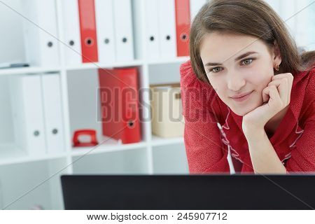 Young Smiling Accountant Working  On A Laptop In The Office. Business, Exchange Market, Job Offer, A