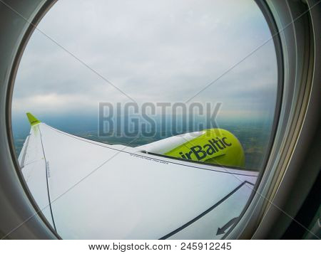 Kaliningrad - Russia, June 16, 2018: Wing of the Air Baltic airlines plane can be seen through the window