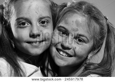 Creativity And Education Concept. Kids With Ponytails Stand Cheek To Cheek. Girls With Happy Faces S