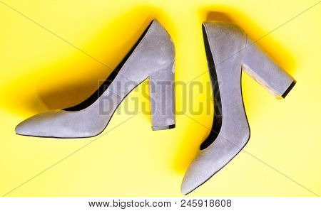 Suede Footwear Concept. Shoes Made Out Of Grey Suede On Yellow Background. Footwear For Women With T