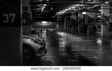 Car Parking In The Shopping Mall Turn On The Lights For Lighting. Silver Car Parked At Block 37 Over