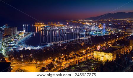 Malaga City With Seafront And Harbor In The Night, Costa Del Sol, Malaga Province, Andalucia, Spain,
