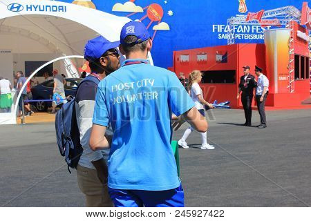 St. Petersburg, Russia - June 18, 2018: Fifa World Cup Russia 2018 Volunteer Helping A Fan. Voluntee