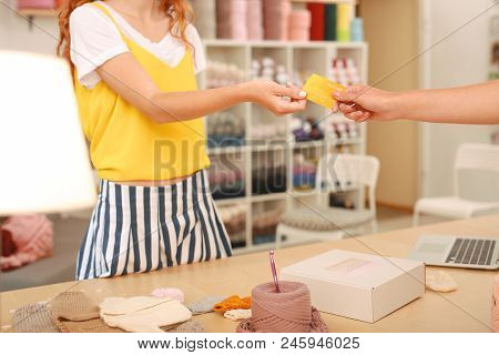 Paying For Order. Regular Customer Feeling Satisfied While Paying For Her Complex Order By Card In F