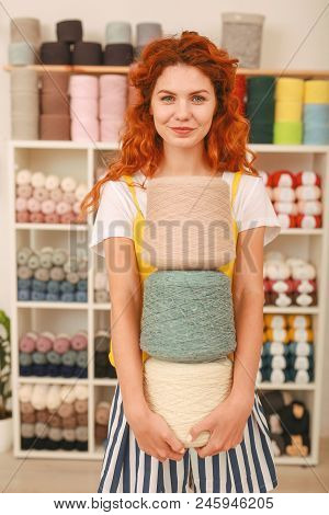 Textile Shop. Beautiful Red-haired Worker Of Famous Textile Shop Enjoying Her Time At Favorite Work