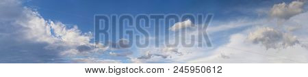 Blue Sky With Fluffy Cumulus And Stratus Clouds Panorama.  Cloudscape Background.  Skyscape  Backgro