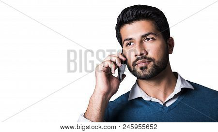 Portrait Of Arabic Serious Smiling Happy Successful Male Man Businessman Or Worker In Blue Sweater A