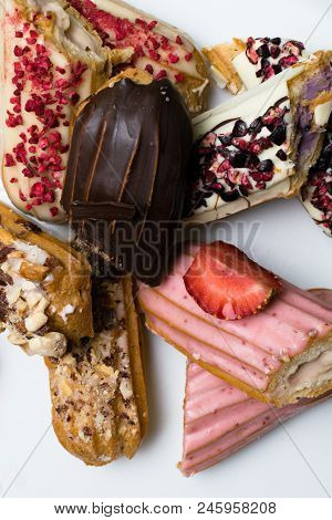 Sweet Delicious Colorful French Eclairs. Group Of French Dessert. Eclair Background. French Pastry G