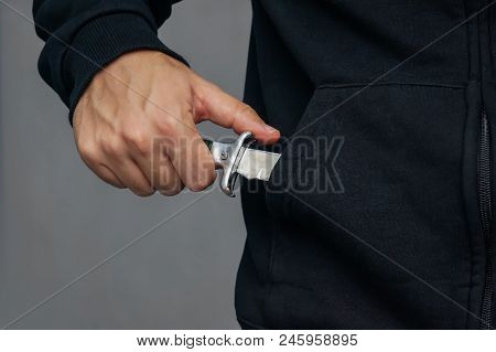 Bandit Pulls Out His Pocket Folding Knife To Threats. A Robber With A Knife In The Hoodie. Mafia.