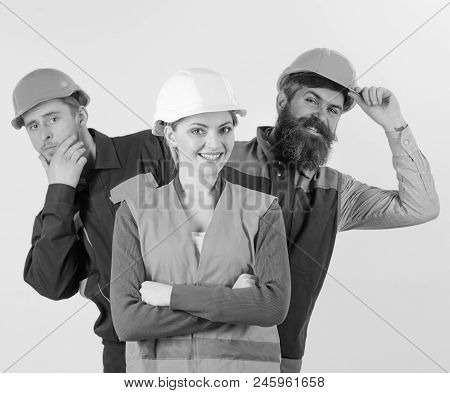 Team Of Architects, Builders, Labourers Peeking Behind Leader Isolated White Background. Female Lead