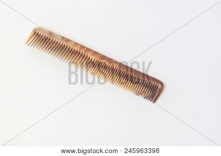 Brown Plastic Comb On White Isolated (white Background)