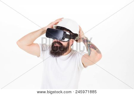 Bearded Man Wearing Helmet To Protect In Virtual Reality Computer Game. Hipster With Stylish Beard T