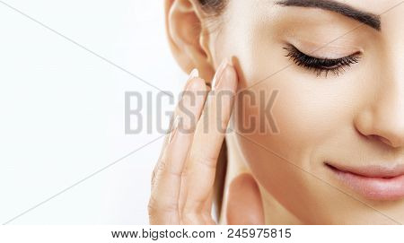 Closeup Happy Young Woman Applying Cream To Her Face Skincare And Cosmetics Concept. Cosmetics. Woma