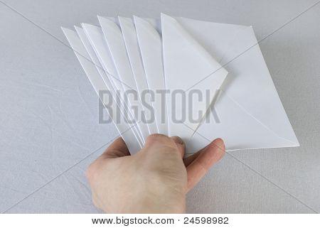Female hand holding an envelopes.