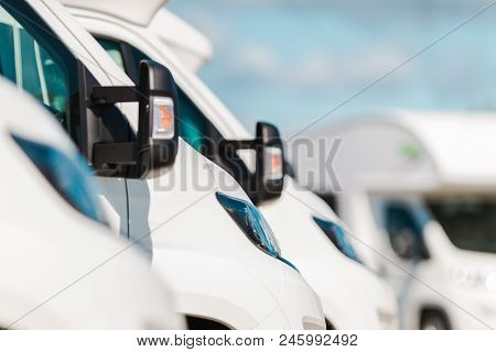 Row Of Camper Vans On The Recreational Vehicles Dealership Lot. Rv Industry.