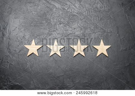 Four Stars On A Dark Background. The Concept Of Rating And Evaluation. The Rating Of The Hotel, Rest