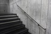 Modern staircase, Staircases in reinforced concrete building, Stainless steel railings inside building, New concrete stairs in office building poster