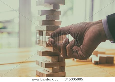 Business Man Gambling Placing Wooden Block. Business Concept  Investment Target And Growth Success P