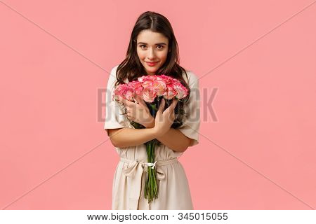 Tenderness, Romance And Love Concept. Attractive Brunette Female, Girlfriend Receiving Beautiful Flo