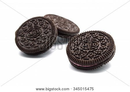 Oreo Biscuits Isolated On White Background. Sandwich Chocolate Cookies With Strawberry And A Sweet C