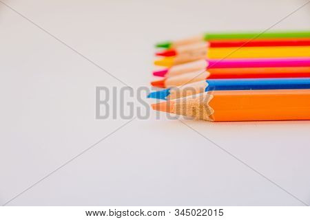 Pallete Of Wooden Pencils Isolated On White Background.pencils Pointing. Deagred Colored Pencils.set