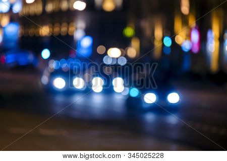 Abstract Blurred Background Of Night City Street. Night Traffic, Colorful Lights