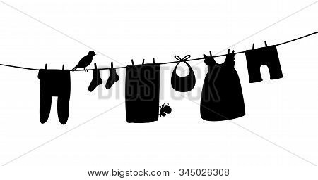 Baby Clothes On Clothesline. Laundry Silhouette Illustration. Kid Apparel After Washing Hanging On A