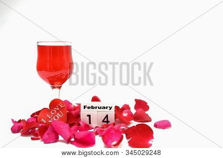 February 14, Valentine, Heart-shaped With Red Rose Petals On A White Background