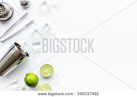 Bar Background. Tools And Ingredients For Making Cocktails. Shaker, Lime, Ice On White Background To