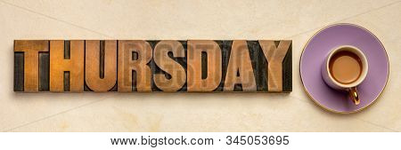 Thursday  word typography - text in letterpress wood type printing blocks with a cup of coffee, the fourth day of the week, calendar and and business concept