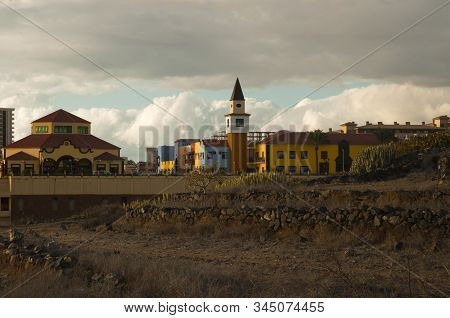 Adeje Town, Santa Cruz De Tenerife, Colourful Village With The Sunset Light On The Desolate Land And
