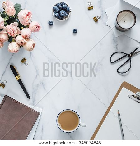 Top View Of Female Home Office With Copy Space In Center. Clipboard, Flowers, Scented Candle On Whit