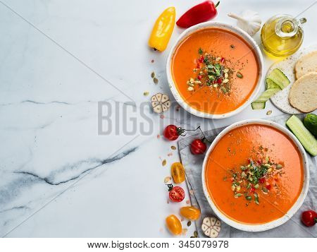 Gaspacho Soup On White Marble Tabletop. Two Bowls Of Traditional Spanish Cold Soup Puree Gaspacho Or