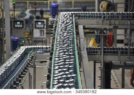 Production Line, Conveyor, Aluminum Cans With Finished Beer On A Conveyor Belt
