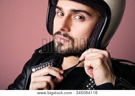 Portrait Of Young Biker Man With White Cafe-racer Helmet. Colourful Background.