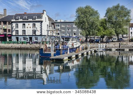 2 June 2018: Plymouth, Devon, Uk - The Barbican With The Three Crowns Public House Reflecting In The