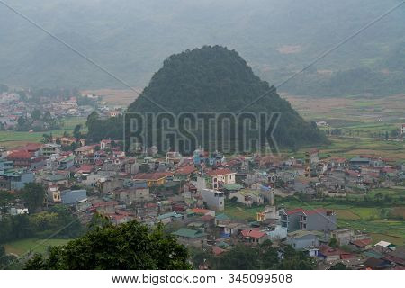 Hazy Day Over Looking Small Picturesque Tom Son Town In Quan Ba Valley, Vietnam Along Ha Giang Motor
