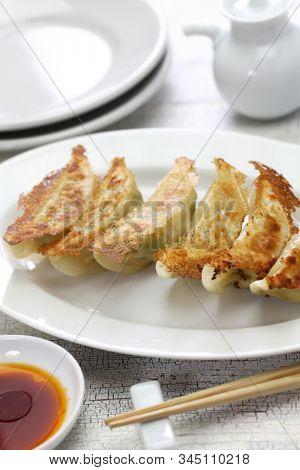 yaki gyoza, potstickers, japanese style pan fried dumplings