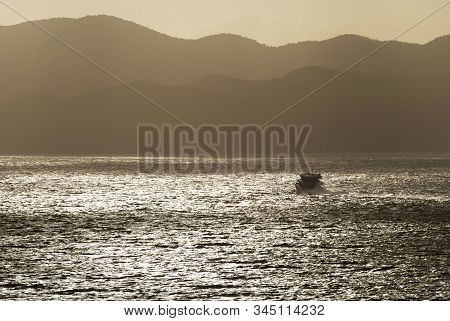 The Motorboat Traveling Across Baughers Bay During The Sunset (tortola, British Virgin Islands).