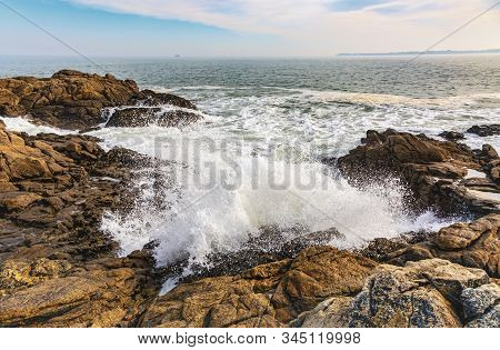 Beautiful Landscape With Waves Crushing On The Rocks On The Brittany Coastline In North Of France.